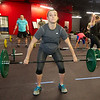 Mother-to-be Bridgett Netherton works out during a cross fit class on Wednesday at Midwestern Built.<br /> Globe | Laurie Sisk
