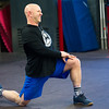 Midwestern Built partner Jason Ansley leads members in stretching before the start of a cross fit class on Wednesday at Midwestern Built.<br /> Globe | Laurie Sisk