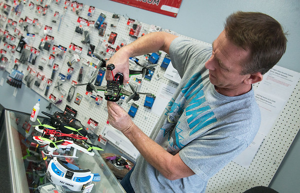 Globe/Roger Nomer<br /> Michael Jones, owner of Blue Sky Hobbies, talks about a racing drone on Friday.