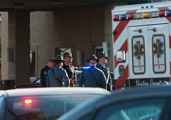 Globe/Roger Nomer<br /> Missouri Highway Patrol and Joplin Police gather at the Econo Lodge on Rangeline following Wednesday's shooting.