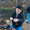 Globe/Roger Nomer<br /> Terry Williams, Clarksville, attatches a lure on Wednesday during opening day at Roaring River State Park.