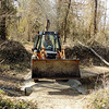 Globe/Marta Churchwell<br /> Volunteer Tom Brown helped dump and pack gravel.