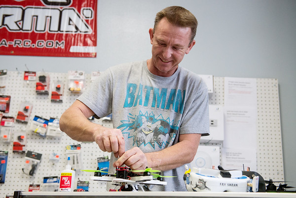 Globe/Roger Nomer<br /> Michael Jones, owner of Blue Sky Hobbies, works on a racing drone on Friday afternoon.