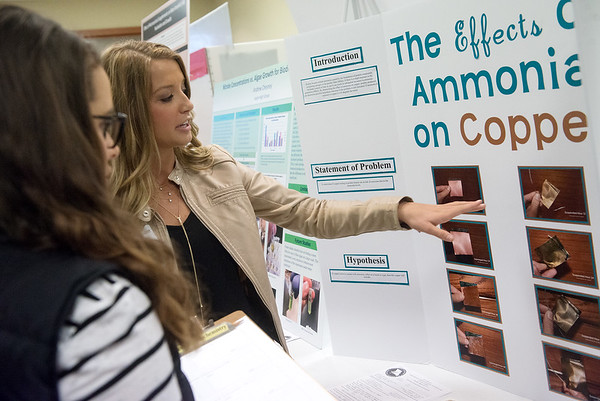 Globe/Roger Nomer<br /> Adison Goostree, right, a Wheaton High senior, talks about her project with judge Sarah Flowers, a Missouri Southern senior from Joplin, on Tuesday at the Science Fair at MSSU.