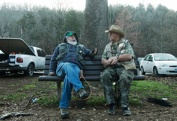 Globe/Roger Nomer<br /> Charles Gibson, left, Lake of the Ozarks, talks with Jim Miller, Aurora, between fishing spots on Wednesday during opening day at Roaring River State Park.