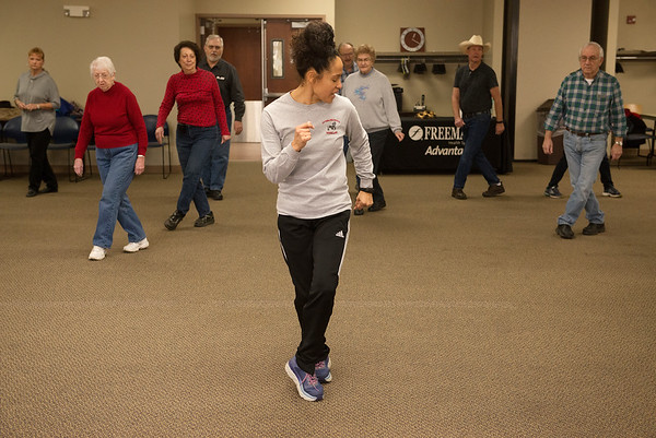Chelsey Powell-Davenport, Freeman Screen Team assistant, leads a line dancing class for Freeman Advantage, a wellness group for older adults, on Monday at the Freeman Business Center.<br /> Globe | Roger Nomer