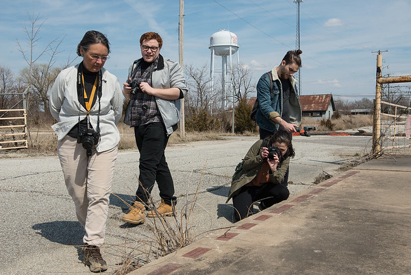 (from left) Rebecca Jim gives Quentin Madia, Lauren Pelaia and Alex Knezevic a tour of Picher, Okla., on Tuesday.<br /> Globe   Roger Nomer