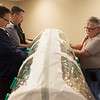 (from left) Mike Ross, director of ambulance services for Freeman Health System, Kyle Bridges, assitant director of nursing for Freeman, and Randy Mitchell, facilities manager at Landmark Hospital, try out an isolation pod on Thursday during the Southwest Healthcare Emergency Preparedness Coalition Conference at the Freeman Business Center. The training tool teaches staff how to provide care and transport Ebola patients inside the isolation pod.  <br /> Globe | Roger Nomer