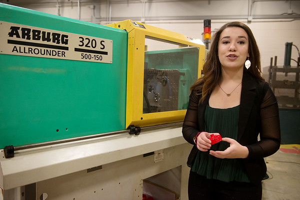 Lexington Peterson, a Pittsburg State sophomore from La Cygne, Kan., talks about an injection molder at PSU's Kansas Technology Center on Feb. 26.<br /> Globe | Roger Nomer