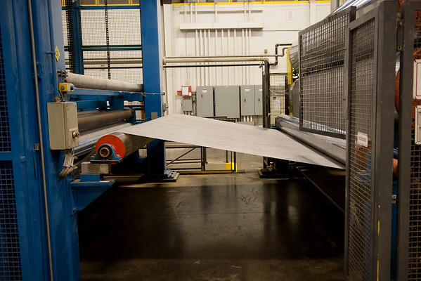 Cloth backing for TAMKO shingles is manufactured in Columbus on Feb. 28.<br /> Globe | Roger Nomer