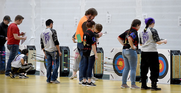 Archers total their points after a Bullseye round during the Sarcoxie archer James Filbeck draws his bow during the Missouri National Archery in the Schools Program's State Qualifying Tournament on Saturday at Leggett & Platt.<br /> Globe | Laurie Sisk