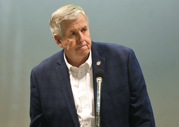 Missouri Gov. Mike Parson answers questions about the Fast Track Worker Development program on Thursday at Liberty Utilities. Swann is a sponsor of the bill, which would provide tuition assistance to qualified persons.<br /> Globe | Laurie SIsk