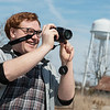 Quentin Madia collects research during a tour of Picher, Okla., on Tuesday.<br /> Globe | Roger Nomer