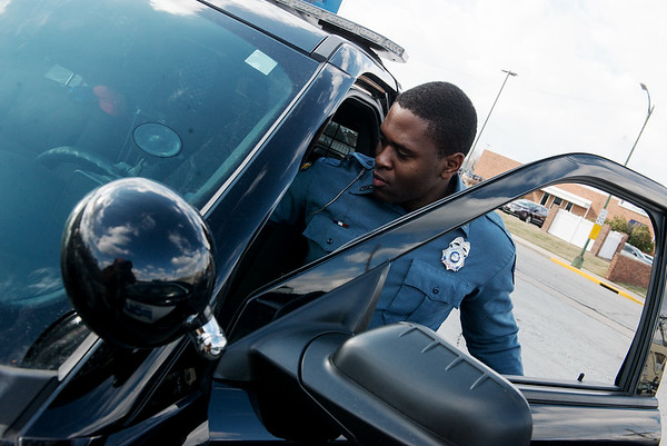 Carthage Patrolman Marcus Wicks works at the Carthage Police Department on Wednesday.<br /> Globe   Roger Nomer