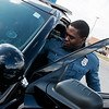 Carthage Patrolman Marcus Wicks works at the Carthage Police Department on Wednesday.<br /> Globe | Roger Nomer