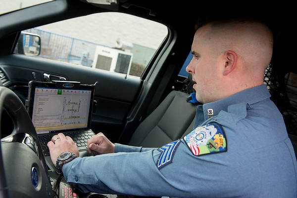 Carthage Sgt. Justin Butler works at the Carthage Police Department on Wednesday.<br /> Globe | Roger Nomer