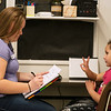 Americorps reading coach Jessica Smith works with Zara Rivera, first grade, on a syllable counting exercise at Purdy Elementary on Wednesday.<br /> Globe | Roger Nomer