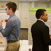 Sam Peterson, Joplin High senior, left, and Sajid Rahiyan, Joplin High senior, talk about their science projects with judges during Tuesday's annual Missouri Southern Regional Science Fair at MSSU.<br /> Globe | Roger Nomer