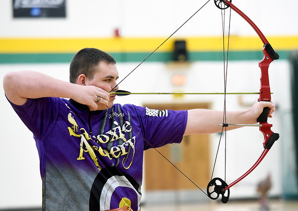 Sarcoxie archer James Filbeck draws his bow during the 3D competition of the Missouri National Archery in the Schools Program's State Qualifying Tournament.on Saturday at Missouri Southern's Robert Ellis Young Gymnasium.<br /> Globe   Laurie Sisk