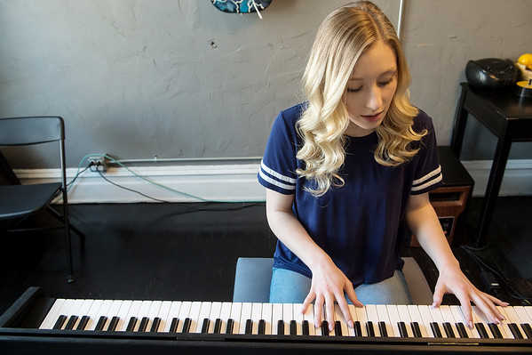 Bailey Moore, 15, practices a song on piano at Maple Leaf Music Company in Carthage on March 22.<br /> Globe | Roger Nomer