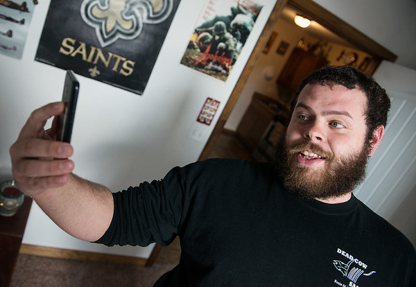 Cameron Summers records a comedy video at his home in Webb City on Wednesday.<br /> Globe | Roger Nomer