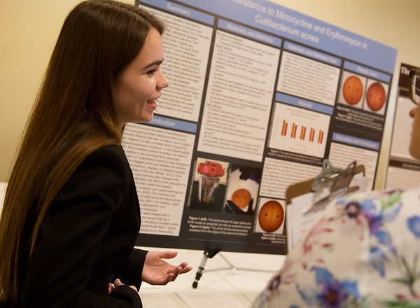 Laura Anderson, Joplin High senior, talks about her project on acne with a judge during Tuesday's annual Missouri Southern Regional Science Fair at MSSU.<br /> Globe | Roger Nomer