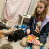 Emma-Grace Shumaker, 8, Carthage, rewards her patient listeners with treats after reading to them on Saturday at the Joplin Humane Society.<br /> Globe | Roger Nomer