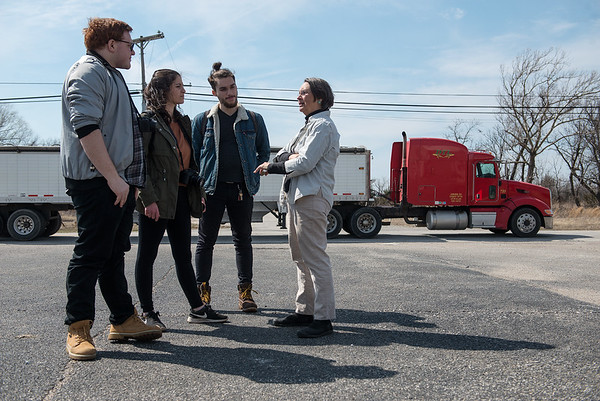 (from left) Quentin Madia, Lauren Pelaia and Alex Knezevic get a tour of Picher, Okla., from Rebecca Jim on Tuesday as a chat truck drives on the highway.<br /> Globe   Roger Nomer