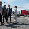 (from left) Quentin Madia, Lauren Pelaia and Alex Knezevic get a tour of Picher, Okla., from Rebecca Jim on Tuesday as a chat truck drives on the highway.<br /> Globe | Roger Nomer
