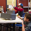 Jaxten McKinney, 10, below, and Keegan Wood, 11, work on making Thor hammers out of recycled materials during the Superhero Adventure Spring Break Camp at the Spiva Center for the Arts on Friday.<br /> Globe | Roger Nomer