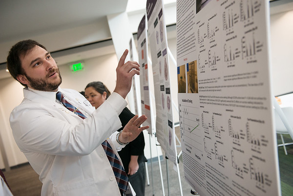 Edwin Glueck, a first year student from Gig Harbor, Wash., talks about his research during Wednesday's research symposium at Kansas City University of Medicine and Biosciences Joplin.<br /> Globe | Roger Nomer