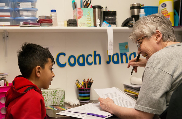 Americorps reading coach Jana Larmer works with Leonel Villa on a reading exercise at Purdy Elementary School on Wednesday.<br /> Globe | Roger Nomer