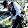 U.S. Navy veteran and former Joplin Postmaster Rodney Bray, of Grove, Okla., removes a rainbow trout from his line during the Rainbows for Vets fishing event on Saturday at the Neosho National Fish Hatchery. Veterans and their families were treated to a Saturday morning of fishing and camaraderie during the event.<br /> Globe | Laurie SIsk