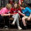 From the left: Martin Luther students Samantha Conrad, 9, Ellah Crawford, 12 and Katie Murdock, 12 collaborate on the spelling of a word during the Joplin Neighborhood Adult Literacy Action's 17th Annual Spell Ball on Tuesday night at St. Paul's United Methosidt Church. The event is a major fundraiser for NALA.<br /> Globe | Laurie SIsk