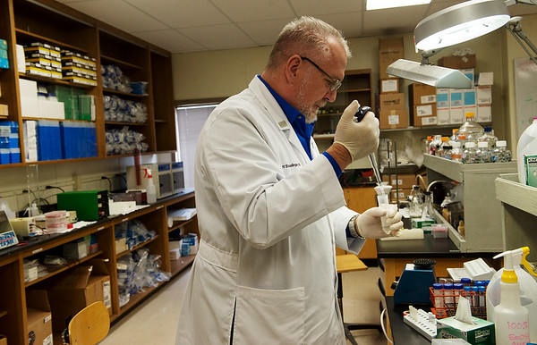 Jeff Staudinger, professor and chairman of the basic sciences division at the Joplin campus of Kansas City University of Medicine and Biosciences, conducts an experiment on Wednesday at Missouri Southern.<br /> Globe | Roger Nomer