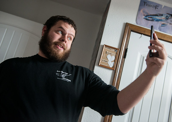 Cameron Summers records a comedy video at his home in Webb City on Wednesday.<br /> Globe   Roger Nomer