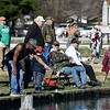 Veterans and their families enjoy a day of fishing during the Rainbows for Vets fishing event on Saturday at the Neosho National Fish Hatchery. <br /> Globe | Laurie SIsk