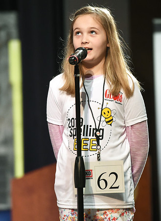Stapleton Elementary fourth grader Olivia Foltz looks for a little help from the heavens during the 42nd Annual Joplin Globe Spelling Bee on Monday at Thomas Jefferson Independent Day School.<br /> Globe   Laurie Sisk
