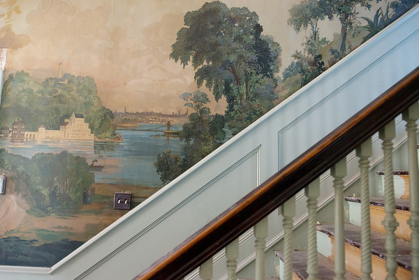 The wallpaper of the Sharp Murphy house is decorated with a painted mural.<br /> Globe | Roger Nomer