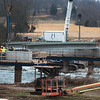 Workers raise girders on the new traffic bridge over Shoal Creek, just east of the low water bridge, on Wendesday morning.<br /> Globe | Roger Nomer