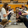 Students work on a dairy judging exam during Thursday's Aggie Day at Crowder College in Neosho.<br /> Globe | Roger Nomer