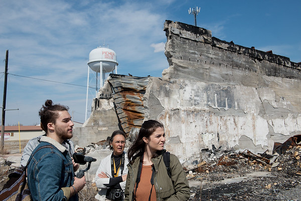 Alex Knezevic and Lauren Pelaia get a tour of the burned pool hall in Picher from Rebecca Jim on Tuesday.<br /> Globe   Roger Nomer