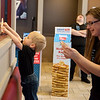 Vincent, 2, and Tracy Wilkowski hang up donation balloons during National Pancake Day on Wednesday at the Joplin IHOP. The restaurant offered free pancakes in exchange for asking for a donation for Children's Miracle Network. Vincent is an ambassador Children's Miracle Network.<br /> Globe | Roger Nomer