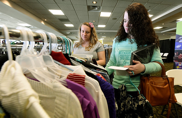 From the left: Missouri Southern Social Work majors Michaela Jones and Stephnie Shaw look through the selection of clothes and accessories at the Dress to Impress event on Wednesday at Missouri Southern. The event offers professional attire to students and is sponsored by MSSU Career Services and a variety of local businesses.<br /> Globe   Laurie SIsk
