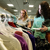 From the left: Missouri Southern Social Work majors Michaela Jones and Stephnie Shaw look through the selection of clothes and accessories at the Dress to Impress event on Wednesday at Missouri Southern. The event offers professional attire to students and is sponsored by MSSU Career Services and a variety of local businesses.<br /> Globe | Laurie SIsk