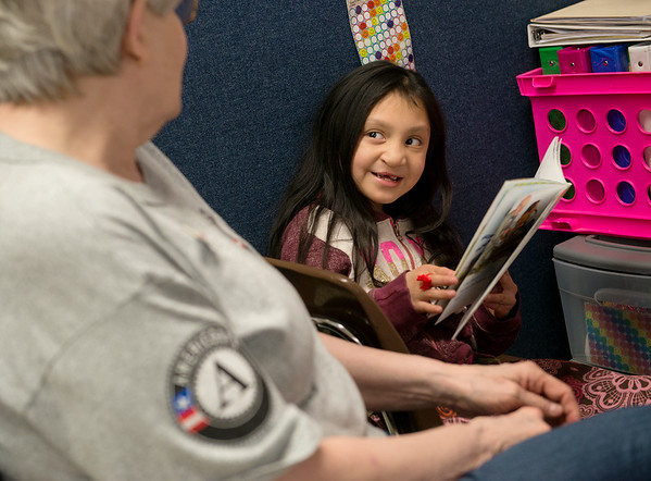 Julia DeLeon, first grade, reads with her AmeriCorps reading coach Jana Larmer on Wednesday at Purdy Elementary School.<br /> Globe | Roger Nomer