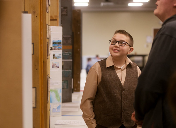 Zachery Webb, a sixth grader at Seneca Intermediate School, gives his presentation on Henry Brown on Friday during History Day at Missouri Southern. <br /> Globe | Roger Nomer