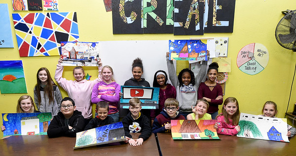 Fifth Grade participants from the Boys and Girls Club of Southwest Missouri pose with some of their work on the 2019 Fair Housing Poster Contest on Tuesday at the club. Winners of the contest were : Brylee Spicer, first place $125, Gabe Matters, second place $75, Brianna Chasten, third place $50, Lance Biggers, fourth place $35 and Cameron Souder, fifth place $25. Twenty children participated in the annual competition, sponsored by the Community Housing Resource Board.  <br /> Globe | Laurie SIsk