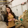 Kalee Hinspeter talks about the roasting process at Downstream Casino's coffee facility on Thursday.<br /> Globe | Roger Nomer