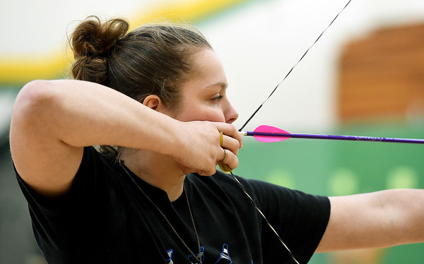 Carthage archer Emily Bowles, 16, competes in the 3D competition of the Missouri National Archery in the Schools Program's State Qualifying Tournament.on Saturday at Missouri Southern's Robert Ellis Young Gymnasium.<br /> Globe | Laurie Sisk